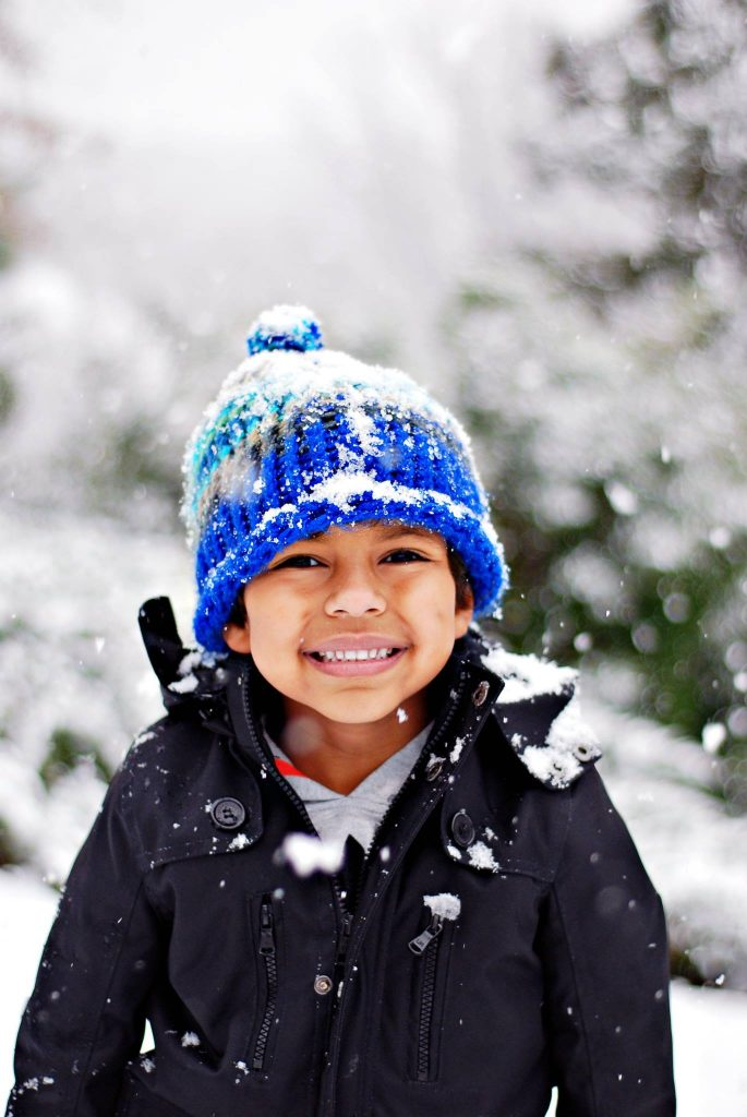 Boy smiling in the snow.
